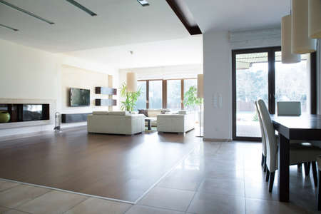 enormous: Photo of spacious house with enormous bright lounge Stock Photo