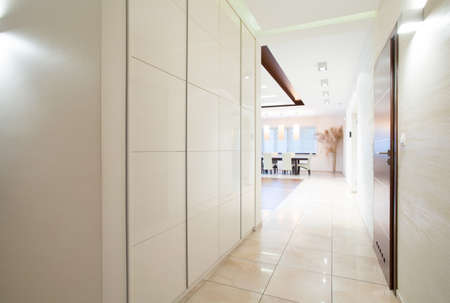 Long white corridor with sliding wardrobe