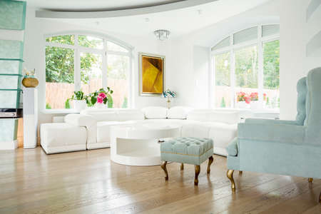 the footstool: Designer armchair in luxury living room interior Stock Photo