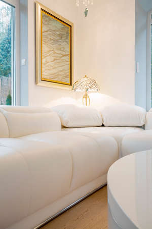 comfy: Comfy white couch inside crystal interior, vertical Stock Photo