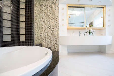 Interior of designed bathroom in expensive residence photo