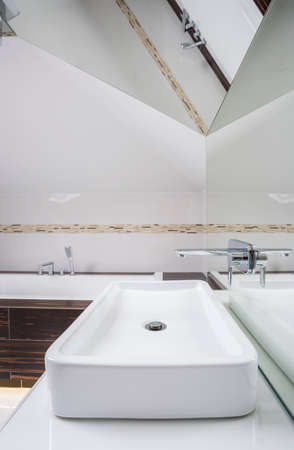 attic: Interior of bathroom in the attic, vertical Stock Photo