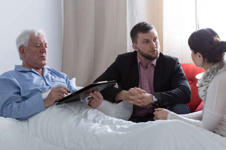 solicitor: Image of terminally ill father making a will Stock Photo