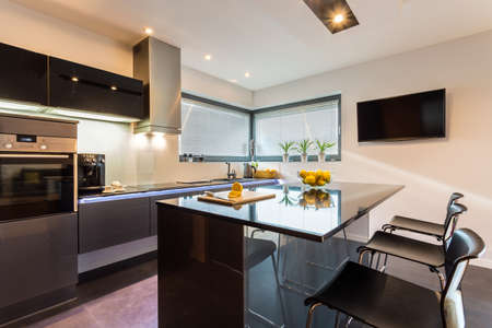 Elegant kitchen and dining interior with silver furniture