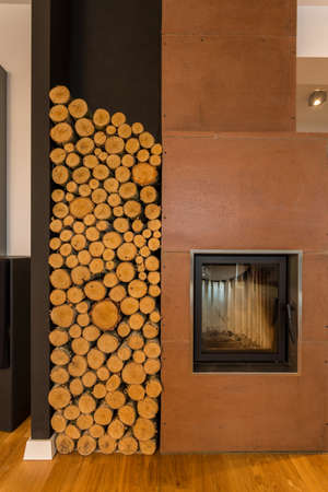 cosy: Cosy interior closeup with fireplace and wood storage space