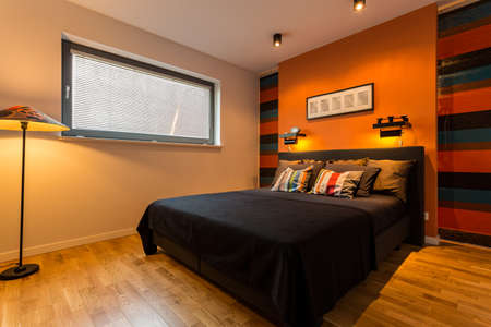 cosy: Elegant bedroom with cosy lights and orange wall