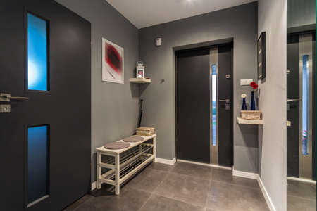cosy: Cosy hall with front door and grey decor Stock Photo