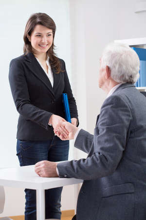 job satisfaction: The end of successful job interview, vertical