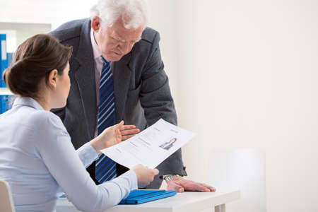 boss and employee: View of boss talking with job candidate Stock Photo