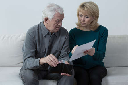 financial problems: Pensioners having financial problems and analyzing bills
