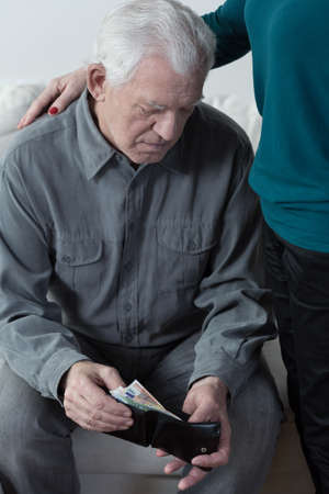 Picture of retired man having financial troubles photo