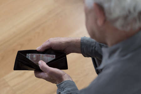 retirement money: Close-up of retired man having financial problems