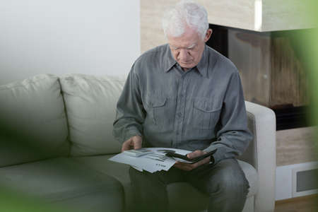 elderly: Horizontal view of elder man in bankrupt Stock Photo