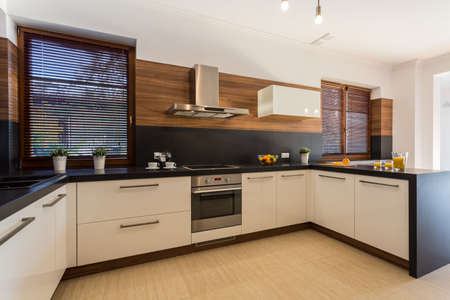 wood blinds: Image of new modern kitchen with wooden floor Stock Photo