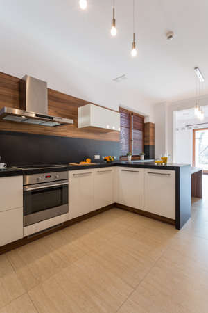 Big bright kitchen with wooden parquet photo