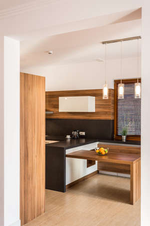 kitchen island: Modern dining room with small wooden table