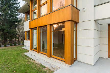 big windows: Big windows with wooden frames overlooking the garden