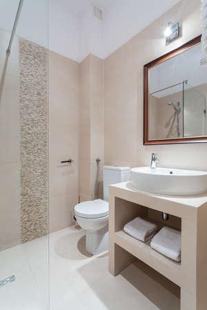 vertical image: Image of new luxury bathroom with white marble floor Stock Photo