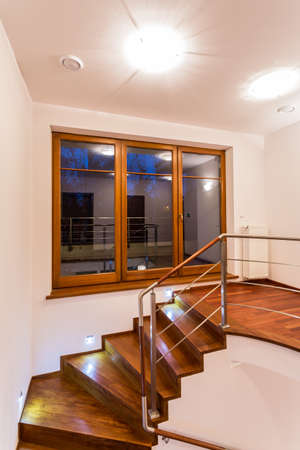 Photo of wooden curly stairs on the first floor photo