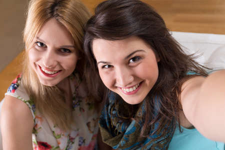 two on top: Photo from the top of two beautiful happy friends Stock Photo