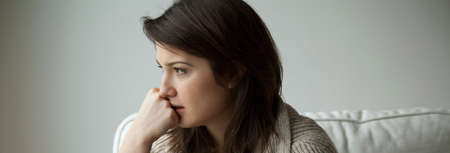 Sad depressed young woman thinking about her life
