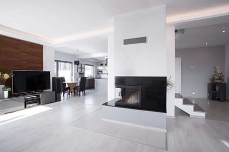 fireplace living room: Horizontal view of bright contemporary mansion interior