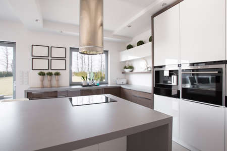 Bright beauty kitchen interior in modern design Banco de Imagens