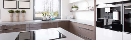 kitchen cabinet: Wooden kitchen cabinet in bright modern kitchen