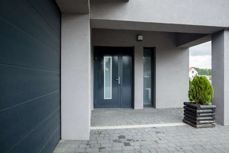 Photo of the luxury stylish blue entrace doors Stock Photo