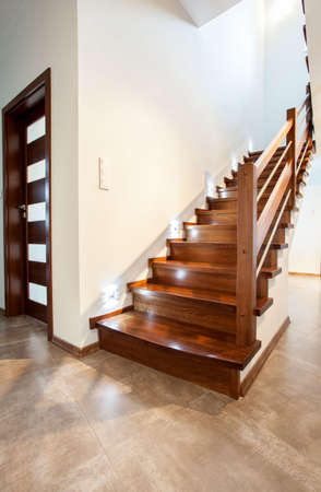 wooden stairs: View of wooden staircase in modern house Stock Photo