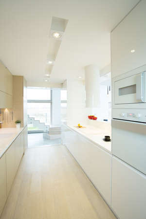 New modern white kitchen with wooden floor photo