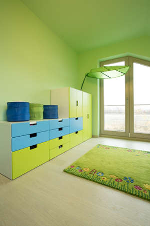 commode: Colorful commode in big green children room