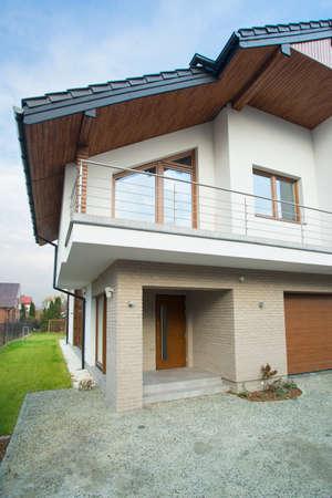 exclusive photo: Photo of front door in big brick residence