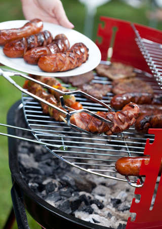 frazzled: Closeup of delicious sausages prepared on grill Stock Photo