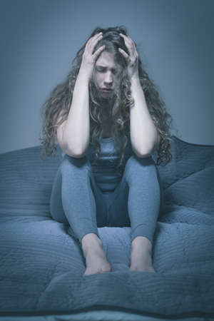 miserable: Lonely young woman having depressing thoughts