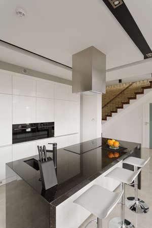 Oranges on granite worktop in modern kitchen photo