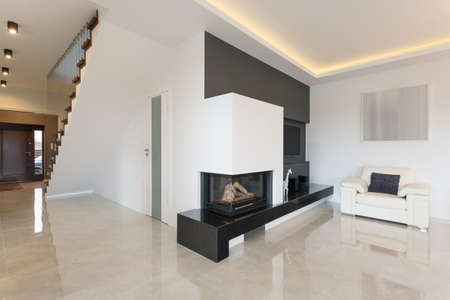 Horizontal view of fireplace in luxury detached house