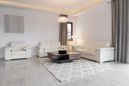 a detached living room: Cream leather couch in exclusive sitting room Stock Photo