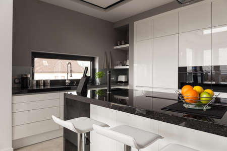 kitchen cabinets: Picture of black and white kitchen design