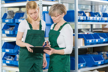 stockroom: View of female storage workers in warehouse