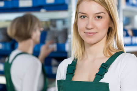 Portrait of beauty female manufacturing worker in warehouse