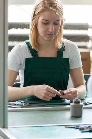 constituent: Attractive female line worker in manufacturing centre Stock Photo