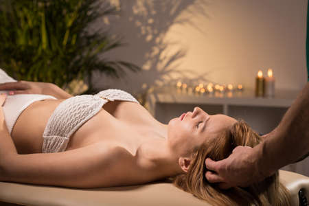 treat acupressure: Beauty woman relaxing during pleasant head massage