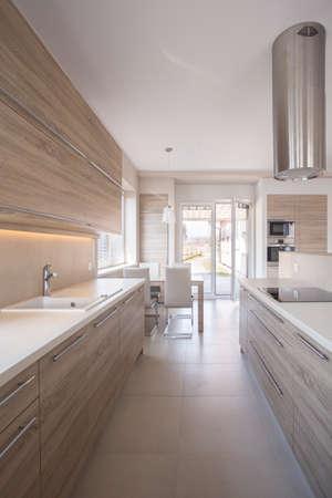 kitchen worktop: Wooden kitchen unit in bright luxury interior