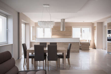 commodious: Dining table set in luxury beige interior