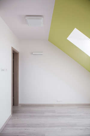 attic: Interior of attic room with sloped ceiling Stock Photo