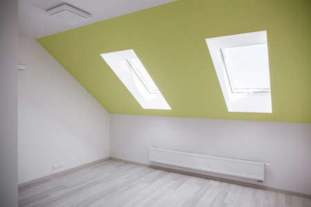 mansard: Empty attic room with white and green walls Stock Photo
