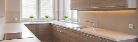 cupboards: Panorama of kitchen interior with wooden cupboards
