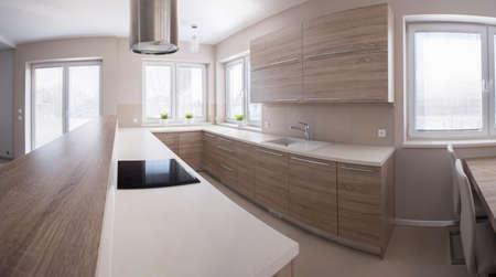 Wooden kitchen cabinet in bright luxury interior