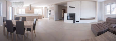 Panorama of beige elegant detached house interior